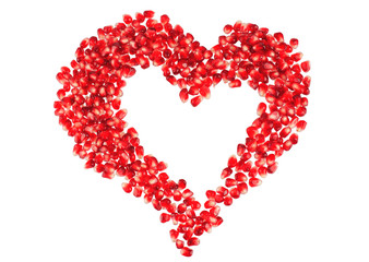 Valentine's heart shape made by pomegranate seeds (isolated on white)