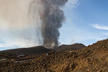 Volcano eruption. Mount Etna erupting from the crater Voragine