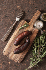 bratwurst grill with salt and pepper and rosemary