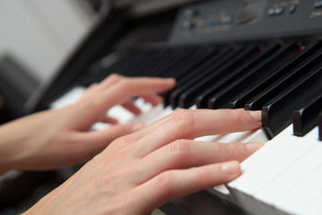 Close up of woman hands playing the piano