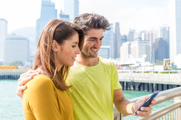 Couple take selfie by smartphone