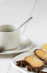 Assorted Cookies and coffee on wooden table