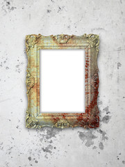 Close-up of one baroque picture frame on weathered wall background