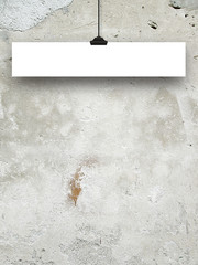 Close-up of one hanged small paper sheet frame with clip on weathered wall background