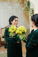 Unusual beautiful bride in a green dress