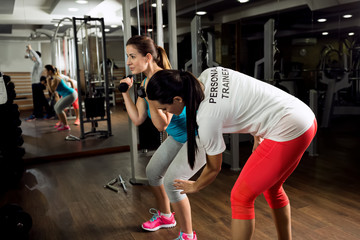 Personal trainer exercise and shows how to workout training