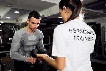 Female trainer doing workout with her client