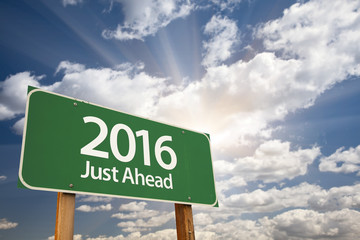 2016 Just Ahead Green Road Sign Against Clouds