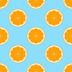 Orange slices on blue background seamless pattern
