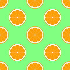 Orange slices on green background seamless pattern