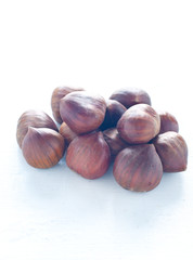 Group of raw chestnuts ready to be cooked