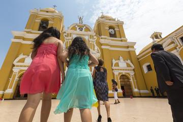 Beautiful Peruvian women during a church ceremony, Trujillo - Pe