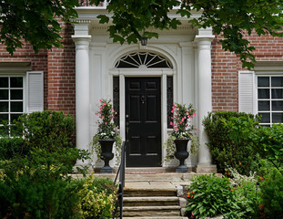 front door with portico entrance and flagstone steps