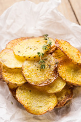 Homemade potato chips with spices