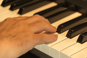 close up of a hand on a piano