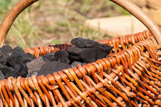 charcoal lying in a wicker basket on