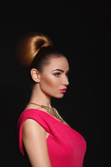 Beautiful sexy woman with dark hair and evening make-up.Jewelry and Beauty. Luxury pink dress