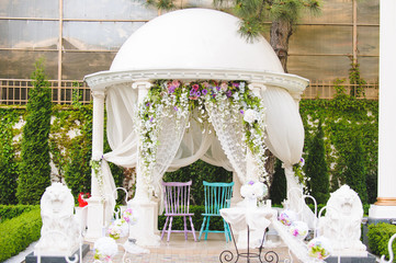 Chairs in Decorated Arbor