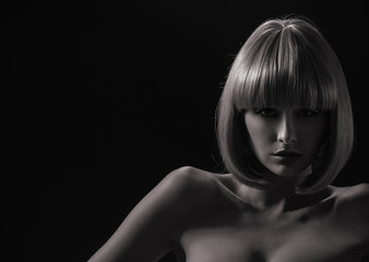 Alluring woman with a trendy coiffure