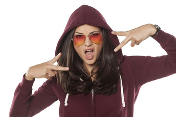beautiful hipster girl with sunglasses and hood