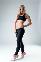 Studio photo of athletic woman with bright makeup