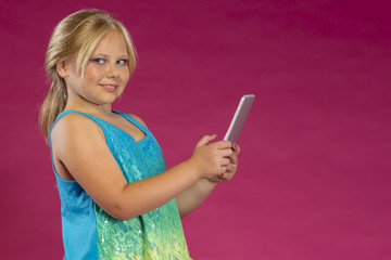 Young Girl Playing With Electronic Devices