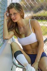 Female Athlete In A Baseball Dugout