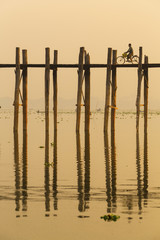 Amarapura, Myanmar - FEBRUARY 21, 2015 : A people cycling on the