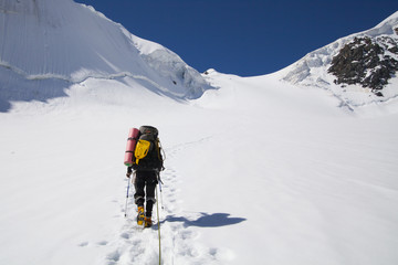 Climber walking up to the peak of mountain