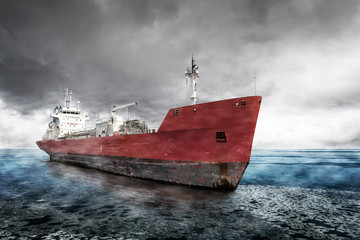 Cargo Ship on the sea with dramatic sky during in winter