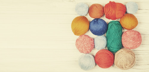 Retro toned yarn balls background, space for text