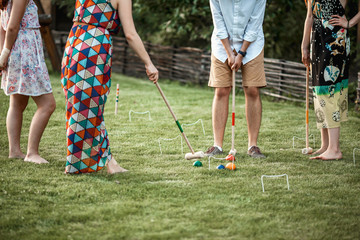 men and women playing Golf on green grass