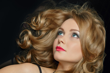 Young blond woman with beautiful hair