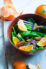 Fresh salad of spinach and mandarin