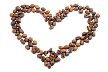Roasted coffee beans in shape of heart, isolated on white