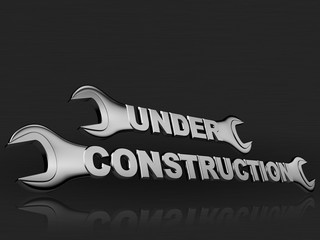 under construction word with a chrome wrench on dark background