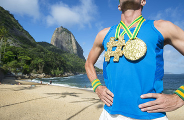 Hashtag gold medal athlete standing at Praia Vermelha Red Beach in Urca, Rio de Janeiro, Brazil
