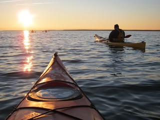 Kayaking at sunset Wall mural