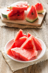 sliced watermelon on white dish