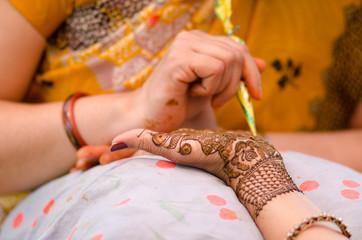 applying henna on hand, wedding ,Rajasthan, India