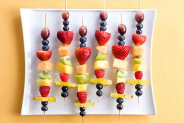 Healthy tropical summer fruit kebabs