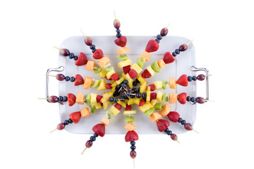Buffet arrangement of healthy fruit kebabs