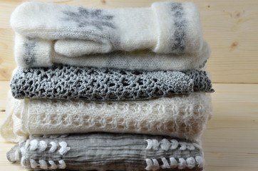 Gray and white woolen sweaters, scarf and gloves