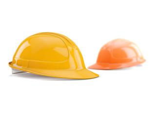 yellow and orange safety helmet on white background, shallow DOF