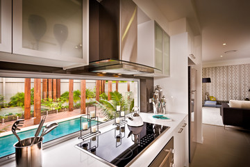 A stylish beautiful kitchen with living room attached