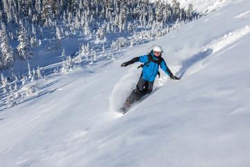 Snowboarder go down mountain slope