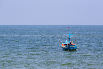 mini single fishery boat floating on sea