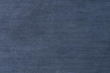 Dark blue, denim texture. Fabric texture of the jeans. Closeup