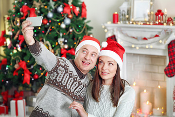 Happy Family making photo on Christmas tree background