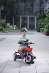 The cute and dull baby ride a bicycle